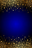 Fondo azul con las chispas del oro Imagen de archivo libre de regalías