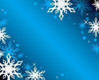Fondo azul con los copos de nieve Imágenes de archivo libres de regalías