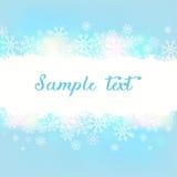Fondo azul con los copos de nieve Foto de archivo libre de regalías