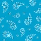 Fondo azul con los copos de nieve Fotografía de archivo