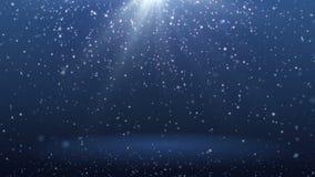 Fondo azul con los copos de nieve que caen abajo y el fondo del spBlue del rayo con las partículas que caen abajo y el lazo del p almacen de metraje de vídeo