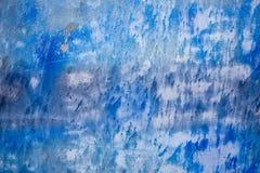 Fondo azul con textura de la tinta en el metal Fotografía de archivo