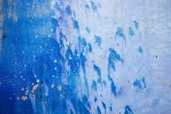Fondo azul con textura de la tinta en el metal Imagen de archivo libre de regalías