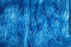 Fondo azul de cuerdas que remolinan Fotografía de archivo libre de regalías