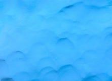 Fondo azul de la arcilla del plasticine Foto de archivo libre de regalías