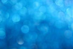 Fondo azul de la falta de definición del extracto de la luz del brillo del invierno fotos de archivo libres de regalías