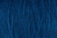 Fondo azul de la mezclilla, textura azul de los vaqueros del dril de algodón Imágenes de archivo libres de regalías