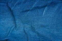 Fondo azul de la mezclilla, textura azul de los vaqueros del dril de algodón Foto de archivo