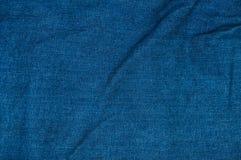 Fondo azul de la mezclilla, textura azul de los vaqueros del dril de algodón Imagen de archivo libre de regalías