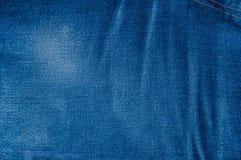Fondo azul de la mezclilla, textura azul de los vaqueros del dril de algodón Fotos de archivo libres de regalías