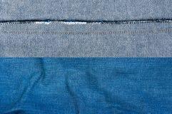 Fondo azul de la mezclilla, textura azul de los vaqueros del dril de algodón Fotografía de archivo