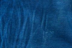 Fondo azul de la mezclilla, textura azul de los vaqueros del dril de algodón Fotos de archivo