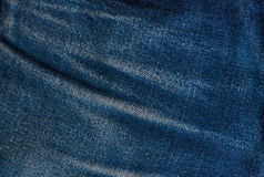 Fondo azul de la mezclilla, textura azul de los vaqueros del dril de algodón Foto de archivo libre de regalías