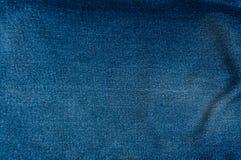 Fondo azul de la mezclilla, textura azul de los vaqueros del dril de algodón Imagenes de archivo