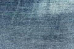 Fondo azul de la mezclilla, textura de los vaqueros del dril de algodón Imagen de archivo