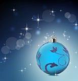 Fondo azul de la Navidad con las estrellas que brillan Fotos de archivo libres de regalías