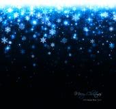 Fondo azul de la Navidad con las estrellas y los copos de nieve fotografía de archivo libre de regalías