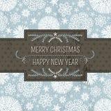Fondo azul de la Navidad con los copos de nieve y el labe Imagen de archivo