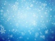 Fondo azul de la Navidad con los copos de nieve