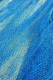 Fondo azul de la red de los pescados Fotografía de archivo libre de regalías
