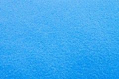 Fondo azul de la tela Foto de archivo libre de regalías