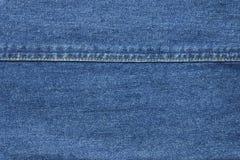 Fondo azul de la textura de la mezclilla con el hilo de la costura fotos de archivo libres de regalías