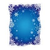 Fondo azul de los copos de nieve de la Navidad Fotos de archivo