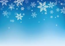 Fondo azul de los copos de nieve para el invierno y el christma foto de archivo libre de regalías