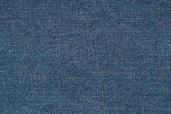 Fondo azul de los pantalones vaqueros del dril de algodón Fotografía de archivo
