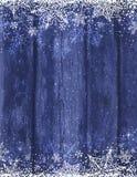 Fondo azul de madera con los copos de nieve, vector de la Navidad Imagen de archivo