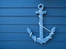 Fondo azul de madera del ancla Fotografía de archivo libre de regalías