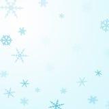 Fondo azul del copo de nieve Fotos de archivo