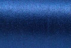 Fondo azul del hilado Foto de archivo libre de regalías