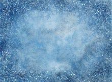 Fondo azul del invierno con los copos de nieve Imagen de archivo libre de regalías