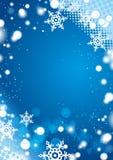 Fondo azul del invierno con los copos de nieve Fotografía de archivo libre de regalías