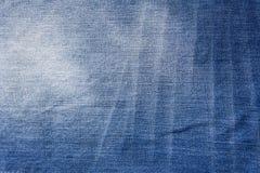 Fondo azul del paño del dril de algodón con algún rasguño Foto de archivo libre de regalías