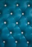 Fondo azul del sofá Imagenes de archivo
