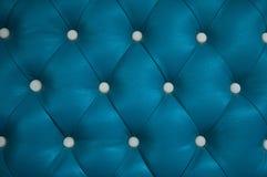 Fondo azul del sofá Foto de archivo libre de regalías