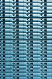 Fondo azul inconsútil del almacenamiento en discos del servidor. Imagen de archivo