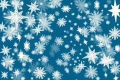 Fondo azul marino de la Navidad con porciones de escamas de la nieve y de st Imagen de archivo libre de regalías