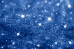 Fondo azul marino de las estrellas y de las chispas del brillo