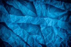 Fondo azul rasgado y arrugado Imágenes de archivo libres de regalías