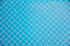 Fondo azul y blanco de la rejilla Imagenes de archivo