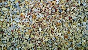 Fondo bajo la forma de piedras coloreadas imagenes de archivo