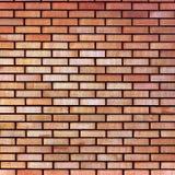 Fondo beige amarillo rojo de la textura de la pared de ladrillo de la multa del moreno, primer detallado grande Fotografía de archivo