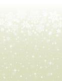 Fondo beige con los copos de nieve Imagenes de archivo
