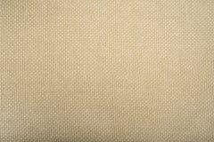 Fondo beige del primo piano di struttura del tessuto della lana fotografia stock libera da diritti