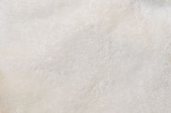 Fondo beige del tessuto della peluche Fotografia Stock
