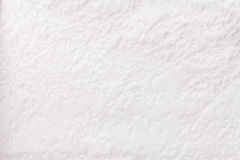 Fondo bianco da una materia tessile molle della tappezzeria, primo piano Fotografia Stock