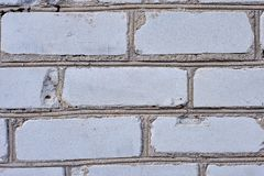 Fondo bianco del muro di mattoni nella stanza rurale, fotografia stock